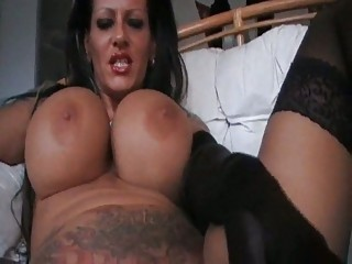 Foxy mega titted MILF smoking in black lingerie