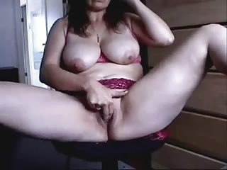 mature playing in front of cam