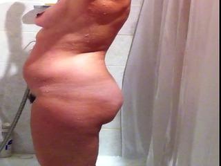 Hidden cam of sexy busty amateur MILF taking a