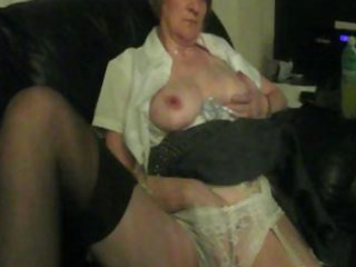 Chubby granny is home alone and gives herself