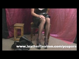 Dirty redhead put on leather skirt and boots and