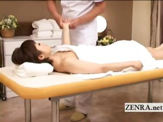 Japanese milf lies nude for sensual erotic oil