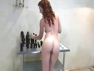 Nasty mature redhead stuffs and stretches her