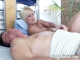 Sexy MILF plays with a huge glass dildo while