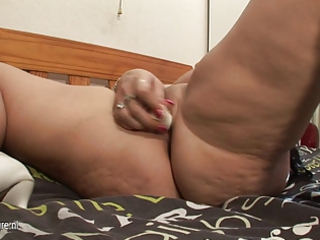 Big titted mother Desiree masturbates on bed