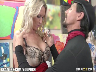 Mature blonde MILF shows off her pierced nipples