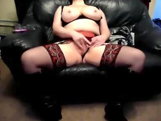 Slutty wife on a leather couch at home