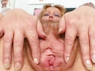 Filthy mature lady toys her hair
