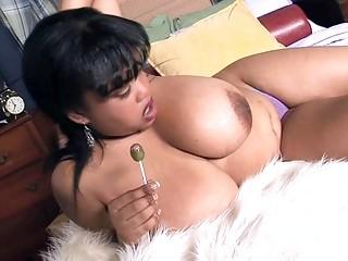 Mega breasted ebony MILF shows off her fantastic