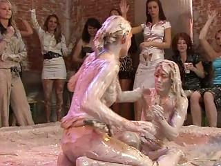 Good looking MILF ladies in lesbo mud wrestling