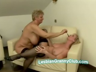 Old blond lady goes naughty licking busty MILF