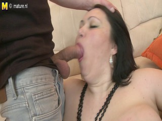 Big titted mother enjoying a young cock