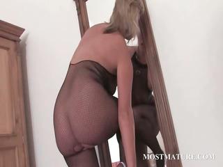 Hot MILF in pantyhose riding dildo