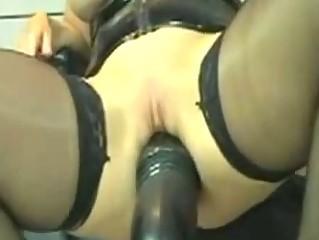 Kinky Leather Milf Marian rides Huge Dildo