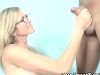 Dirty blonde milf has her hands ful