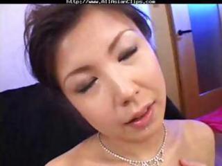 Busty Oriental MILF Asaoka eats three cocks and
