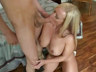 Blonde luty milf with huge tits gives blowjob to
