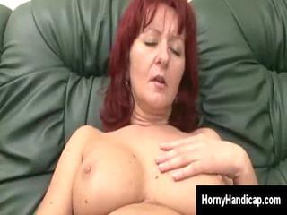 Mature redhead goes naughty masturbating on the
