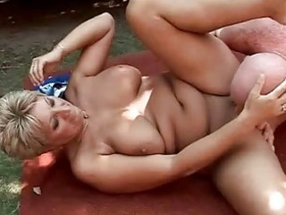 Busty grandma enjoying hard sex outdoor