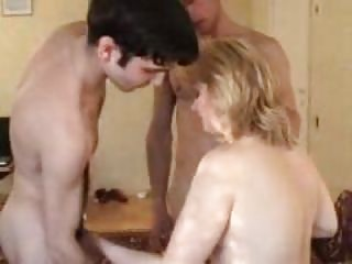 Filming his swinger wife with two young guys