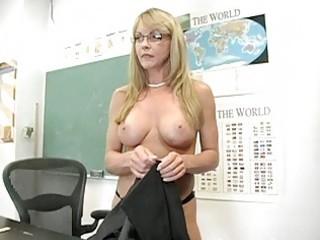 Blonde mature teacher shows off her impressive