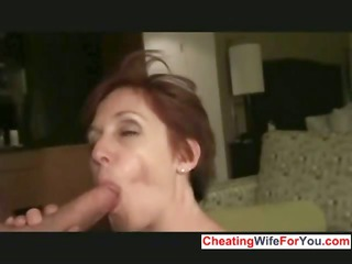 Mature slut get facial from two cocks