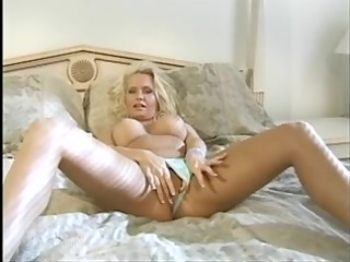Older golden-haired chick fingers and tastes her