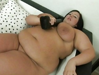 Large dark haired momma with big breasts uses her