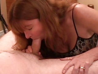 Heavy chested redhead milf gives hot blowjob in