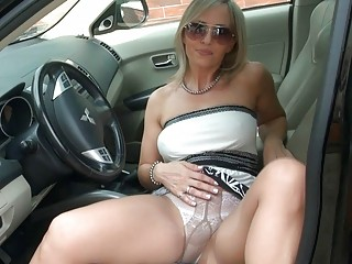 Stunning blonde milf in pantyhose shows her