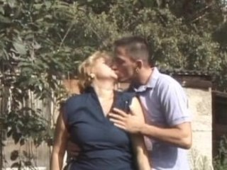 Mature woman and young boy 7