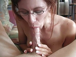 Mature redhead momma with glasses doing deep