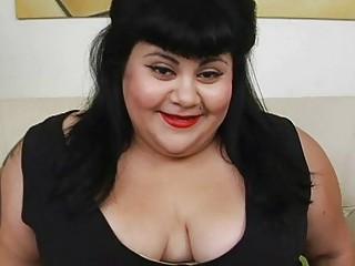 Fat dark haired momma with tattoo masturbates on