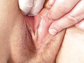 Fat granny wench gets her shaved cunt examined