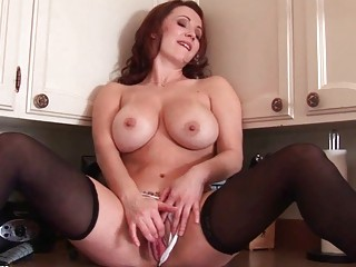 Busty redhead MILF babe toys her fanny in the