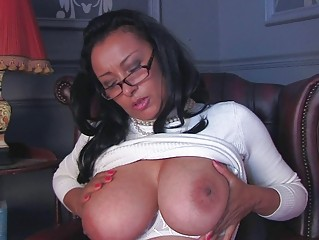 Arousing dark haired milf wth glasses and huge