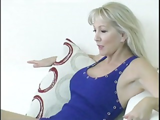 Busty mature blonde gets her feet licked and then