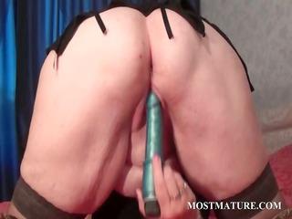 Blonde mature tramp licking her big tits