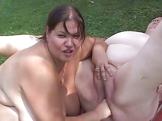 Two fat matures in action outdoor